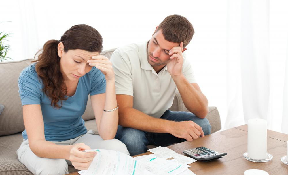 couple-looking-over-bills-and-distressed