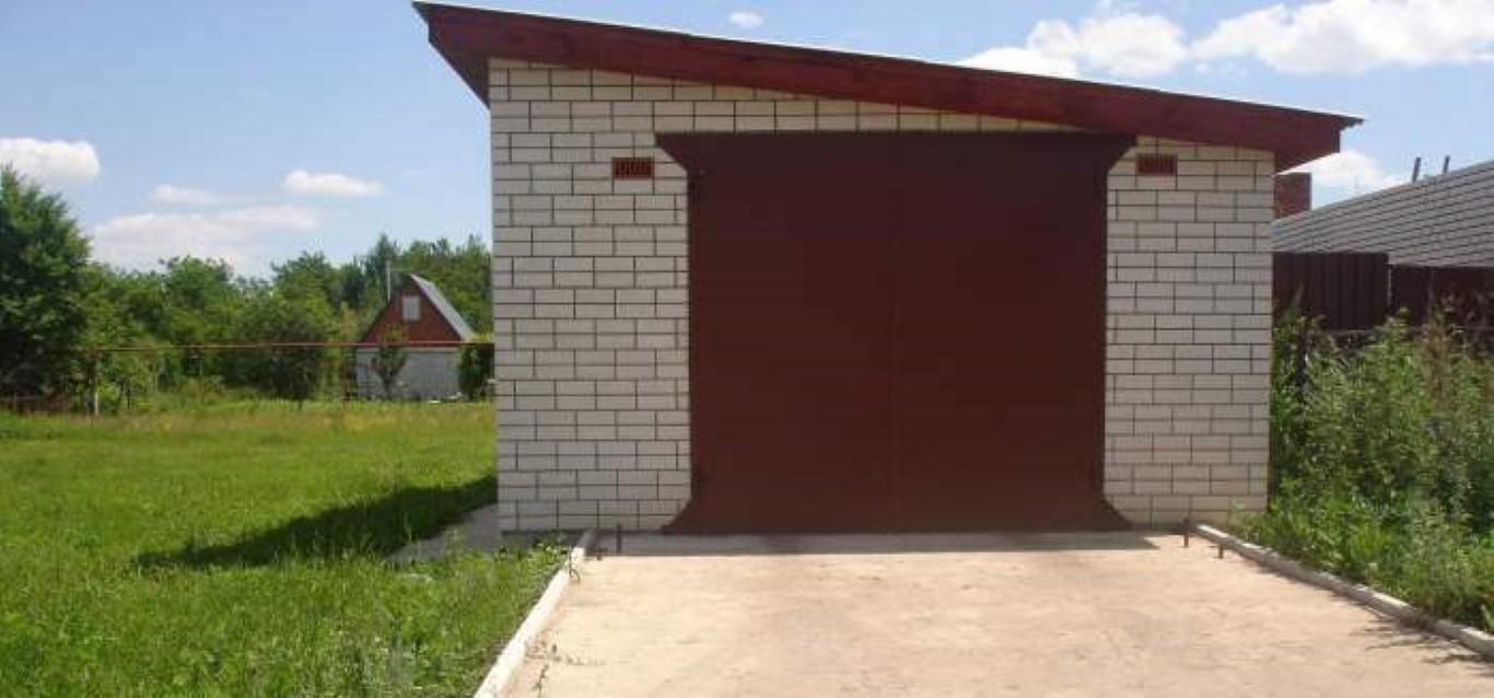 Постройка гаража от забора